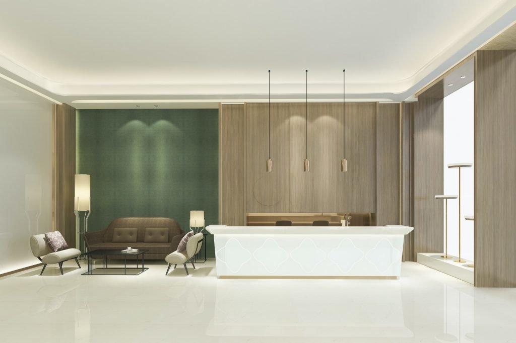 Todo Servicio servicios integrales Gran salón de recepción de hotel de lujo con tono verde estilo asiático